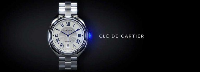 reloj cartier en fondo negro con una luz azul